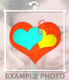 Dos corazones unidos con un clip que podrás poner en tus imagenes con este editor de pegatinas online