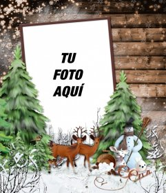 Marco de fotos de invierno con un paisaje nevado, unos ciervos y un muñeco de nieve