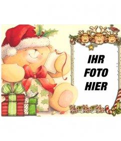 Weihnachtskarte für einen Fotorahmen auf dem Rahmen schauen drei Rentiere und einen roten Vogel