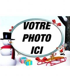 Noël cadre photo dans la neige avec un bonhomme de neige et des cadeaux de mettre une photo