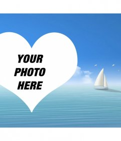 Photomontage with a heart in the sea and a sailboat in the background