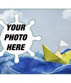 Sailing collage with a paper boat on a painted background and a photo frame rudder-shaped