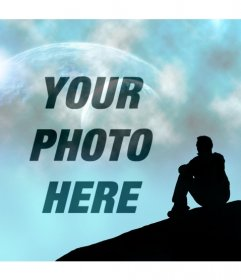 Create a photomontage with a fantasy landscape in which you can see a blue sky with two planets and the silhouette of a man sit looking at the sky where you will place your picture