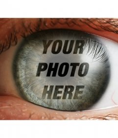 Create a photomontage with one eye and a superimposed picture over the iris and pupil as reflecting