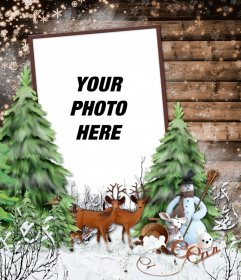 Photo frame with a snowy winter landscape, a deer and a snowman