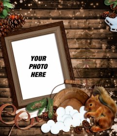 Photomontage of winter with a wooden photo frame decorated with a sled, a squirrel and several cones