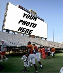 In this photomontage, your photo will appear on the big screen in a football stadium, where people, including players