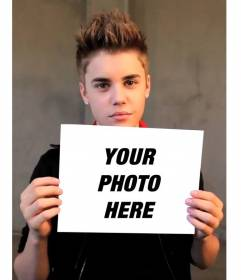 Photomontage with Justin Bieber with short hair holding up your picture